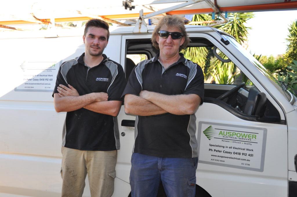Peter Casey standing in front of Auspower van