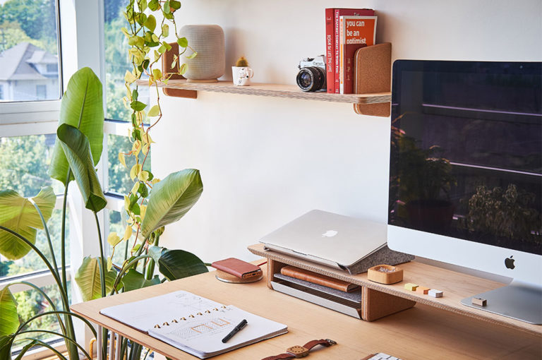 Stylish looking desk with iMac and MacBook Pro